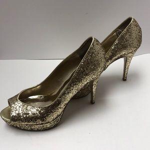 guess gold heeled shoe